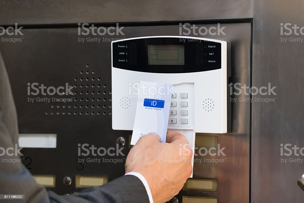 Close-up Of Businessperson Holding Keycard For Security System stock photo