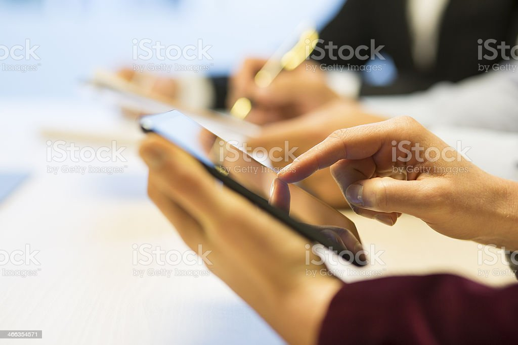Close-up of Businesswoman hands working with tablet pc during a royalty-free stock photo