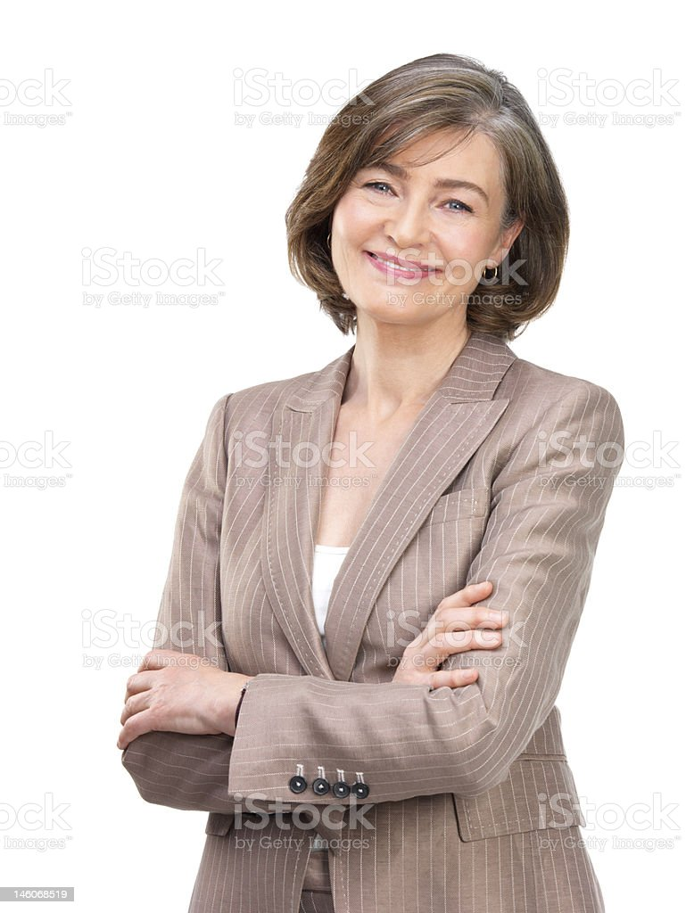 Close-up of businesswoman smiling with arms crossed against white background stock photo