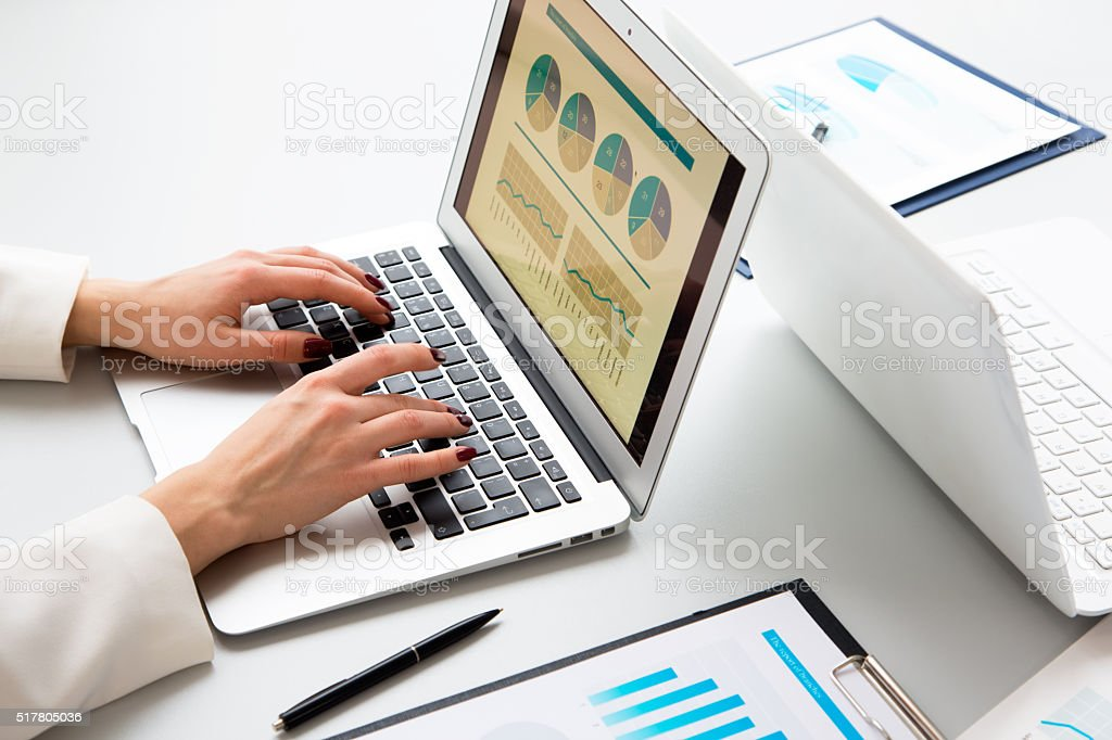 Closeup of businesswoman typing on laptop computer stock photo