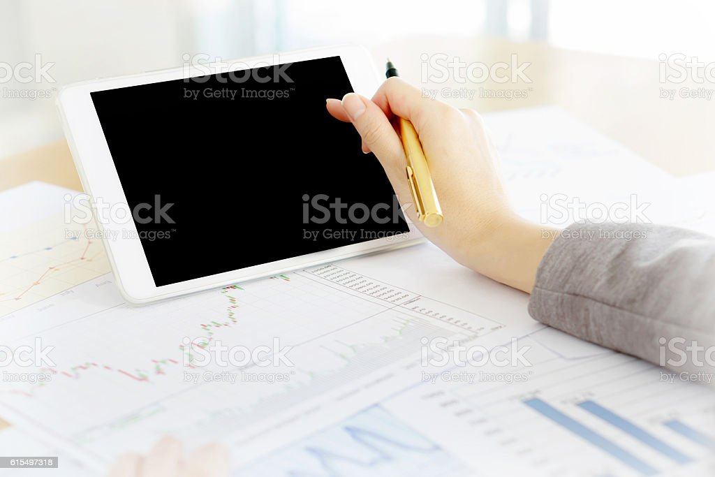 Close-up Of Businesswoman With Digital Tablet And Document stock photo