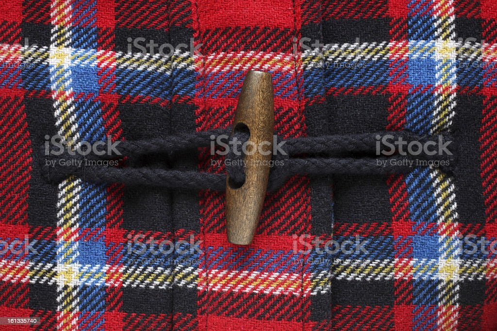 Close-up of button on checkered coat royalty-free stock photo