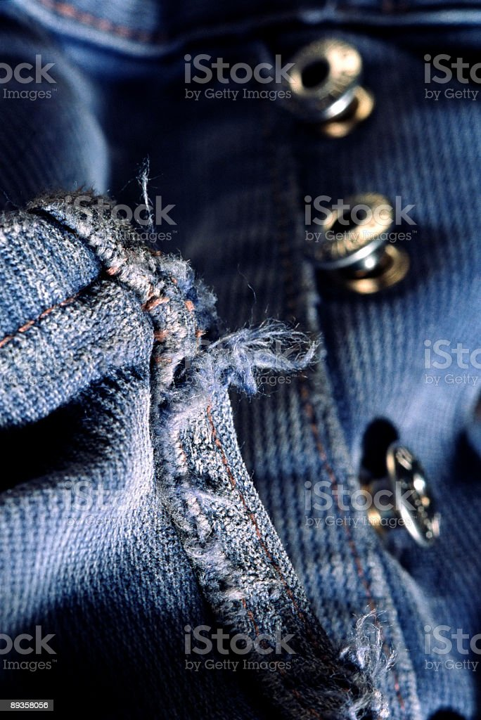 Close-up of buttons in blue jeans, studio shot stock photo