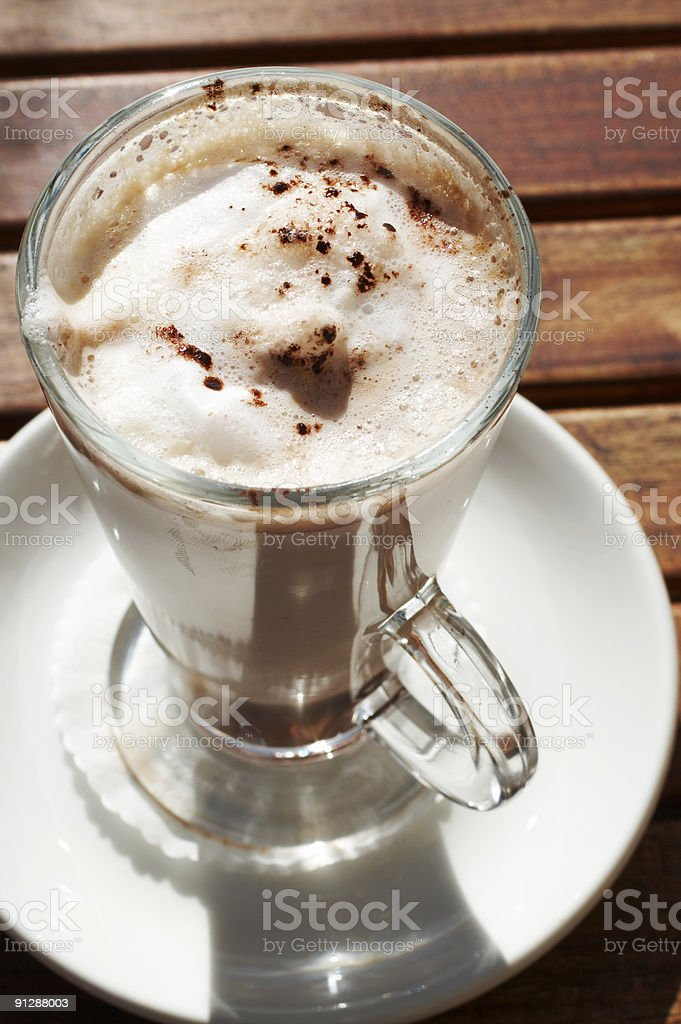 Closeup of cafe latte in long glass cup royalty-free stock photo