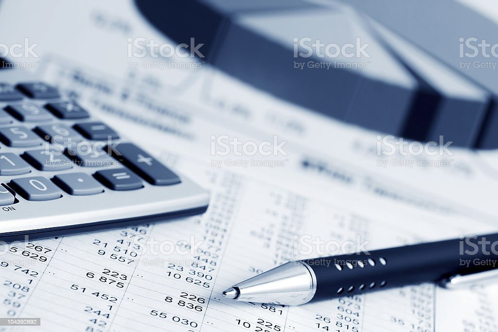 Close-up of calculator, pen and accounting documents stock photo