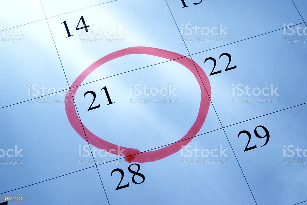 Close-up of calendar with red circle mark, setting a date stock photo
