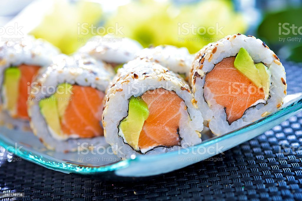 Closeup of California maki sushi rolls on a glass plate stock photo