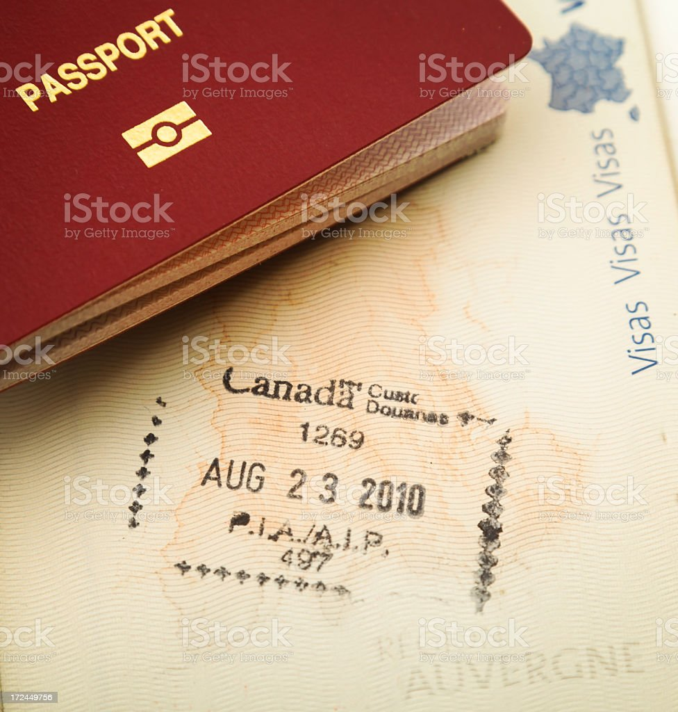 Close-up of Canadian custom stamp from 2010 next to passport stock photo