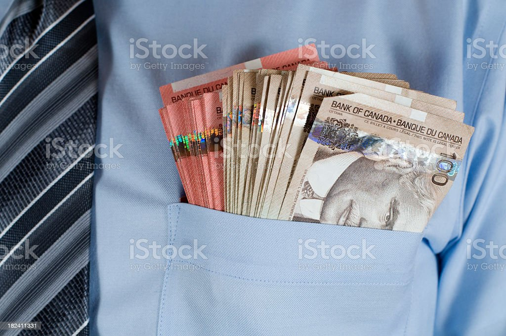 A close-up of Canadian money in a shirt pocket royalty-free stock photo
