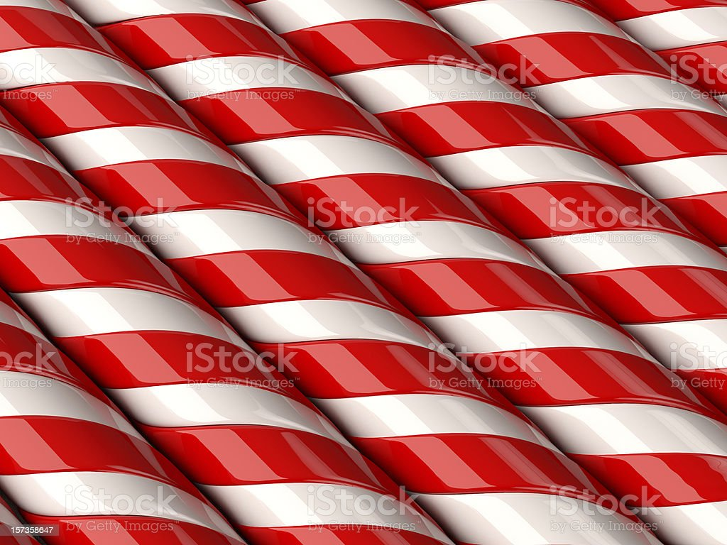 Close-up of candy canes in red and white in a line stock photo