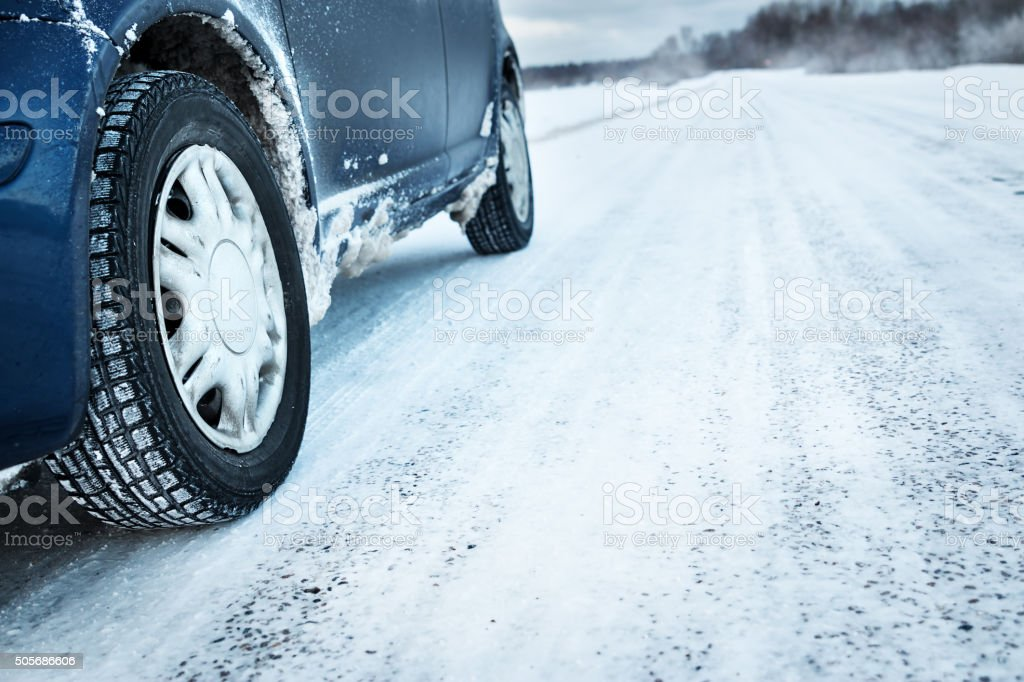 Closeup of car tires in winter stock photo