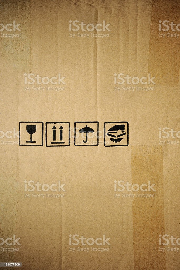 Close-up of cardboard box with symbol mark royalty-free stock photo