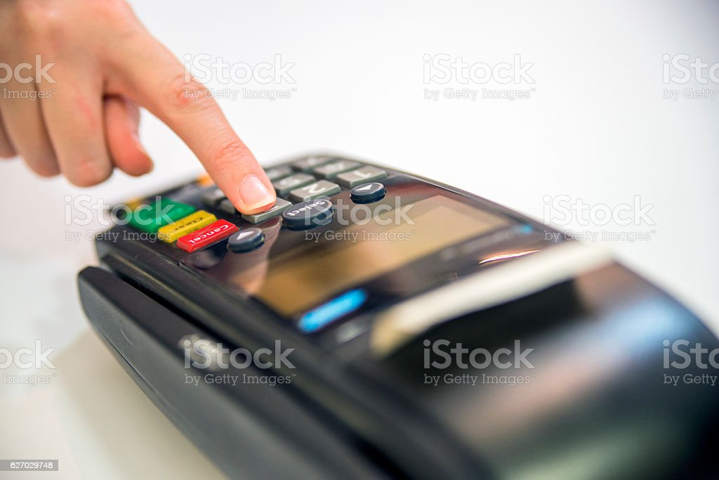 Close-up of cards servicing with POS-terminal, isolated on white stock photo
