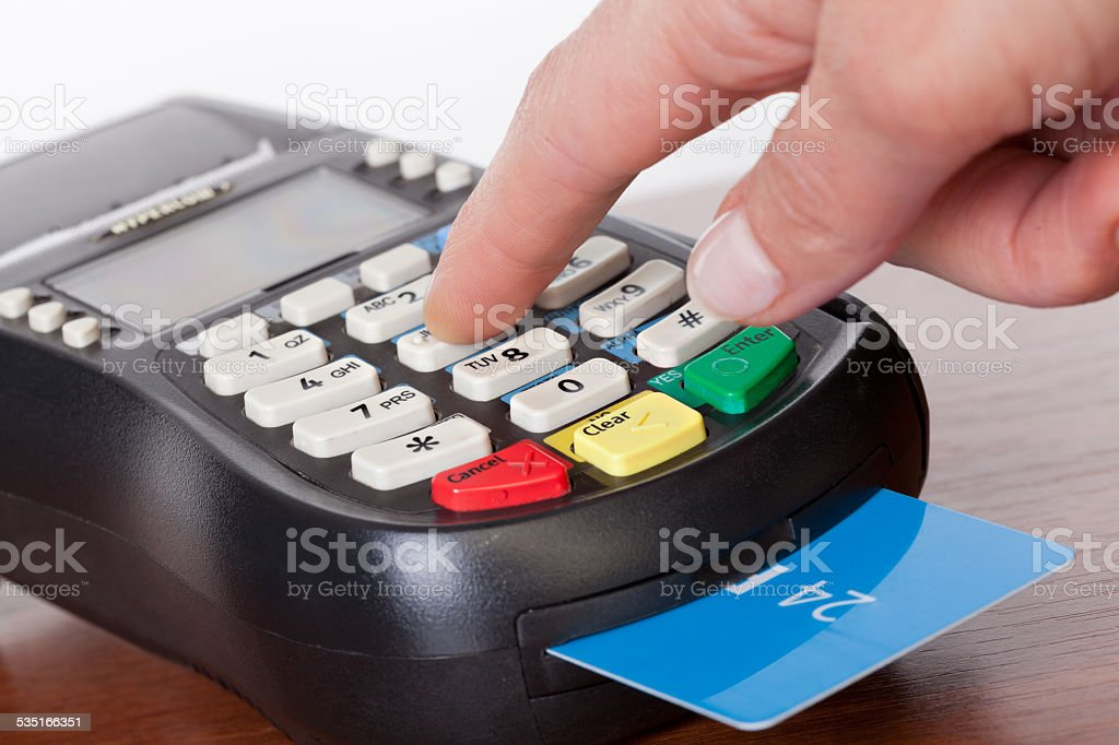 Close-up of cards servicing with POS-terminal stock photo