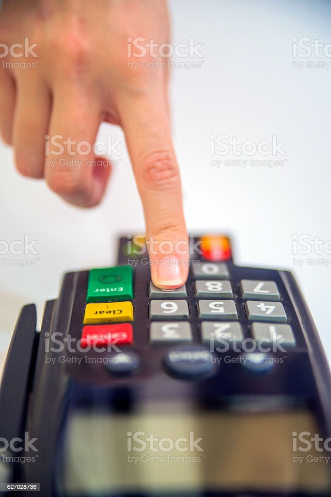 Close-up of cards servicing with POS-terminal. stock photo
