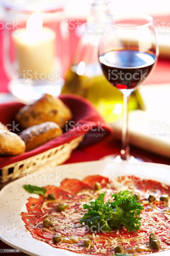 Close-up of carpaccio dish with red wine royalty-free stock photo