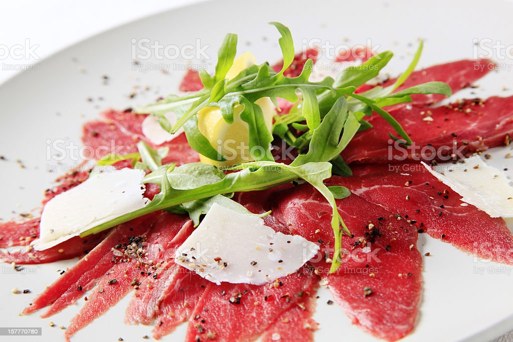 Close-up of carpaccio on white plate stock photo