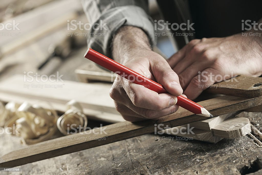 Close-up of carpenter marking a wooden plank stock photo