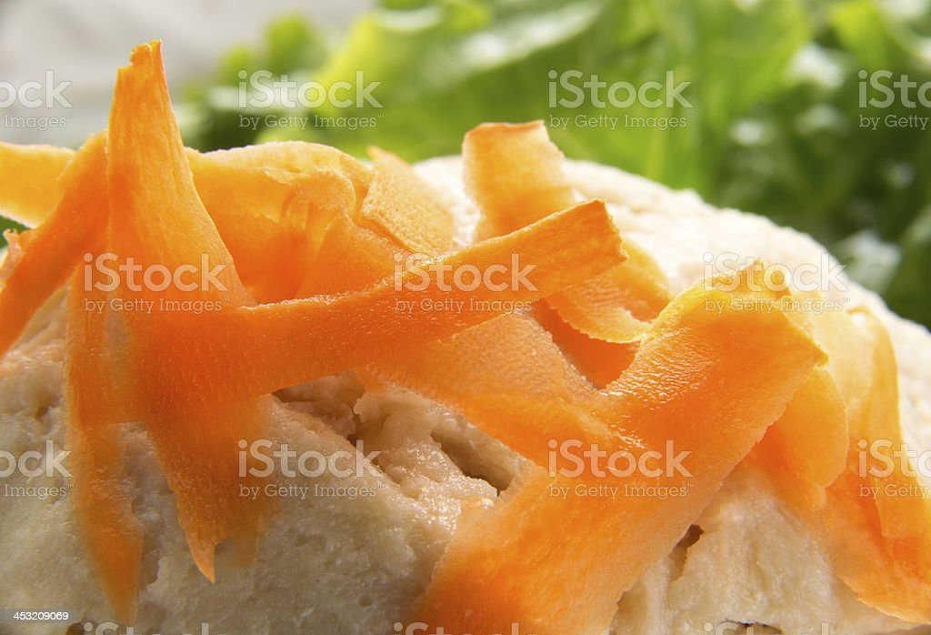 Closeup of carrot shavings on Gefilte Fish royalty-free stock photo