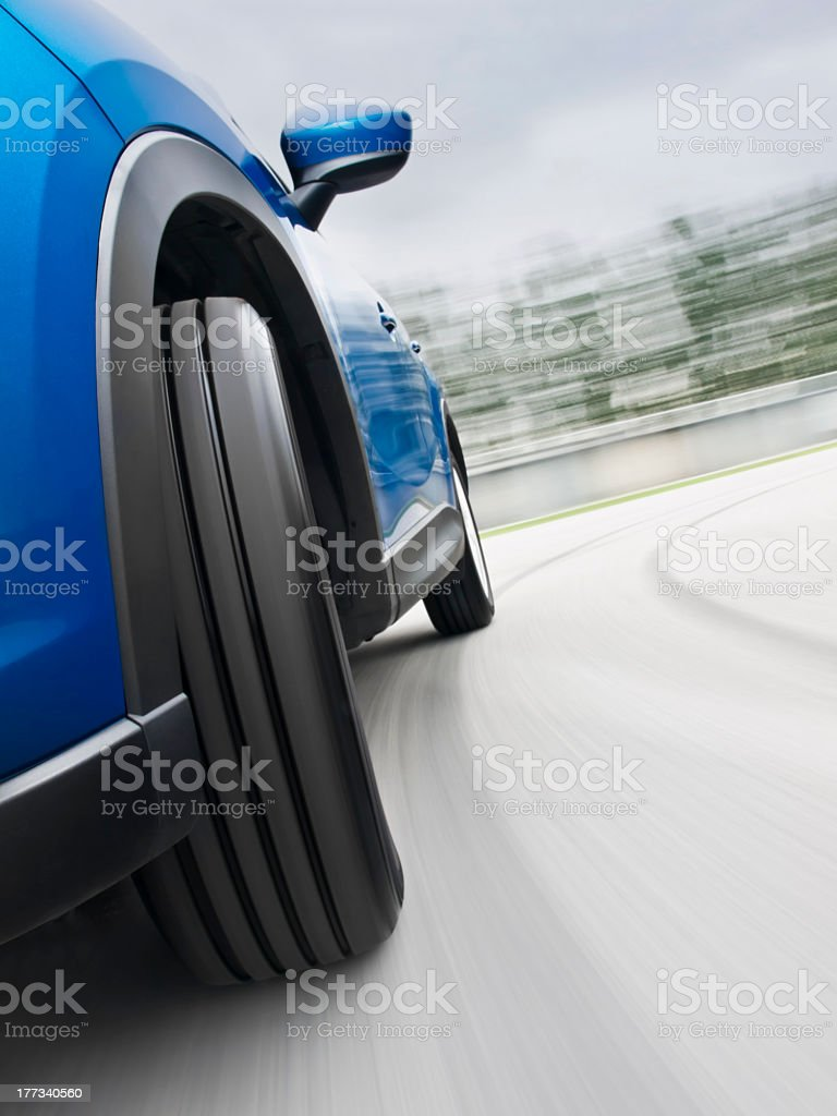 Close-up of car's wheel in a speedy turning stock photo