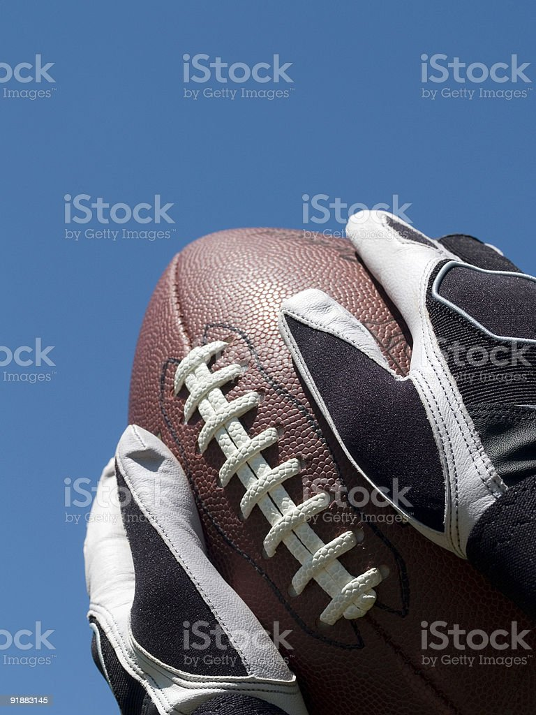 Closeup of Catching Football royalty-free stock photo