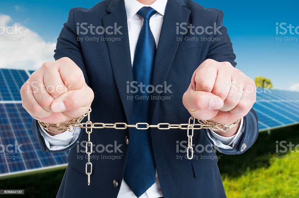 Closeup of chained businessman hands stock photo