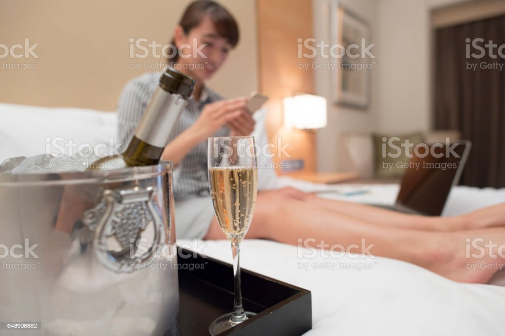 Closeup of champagne and ice bucket and glass. stock photo