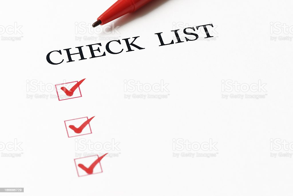 Close-up of checklist with red ball point pen royalty-free stock photo