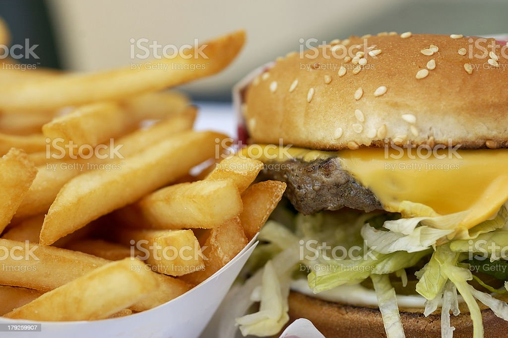 Close-up of cheeseburger and french fries stock photo