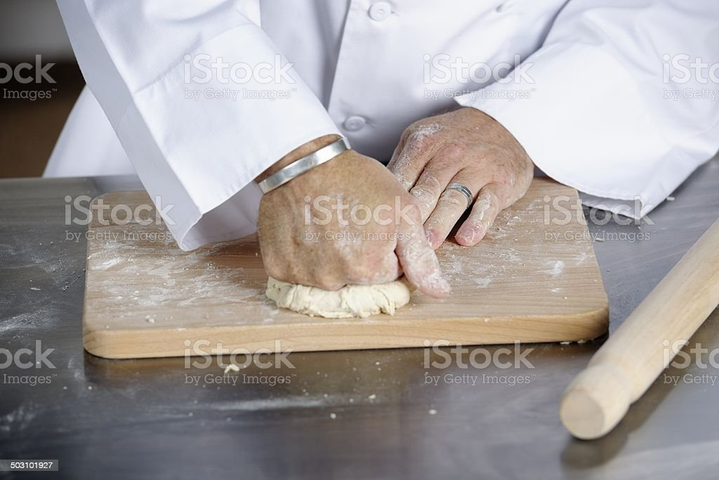 Close-up Of Chef Rolling Dough royalty-free stock photo