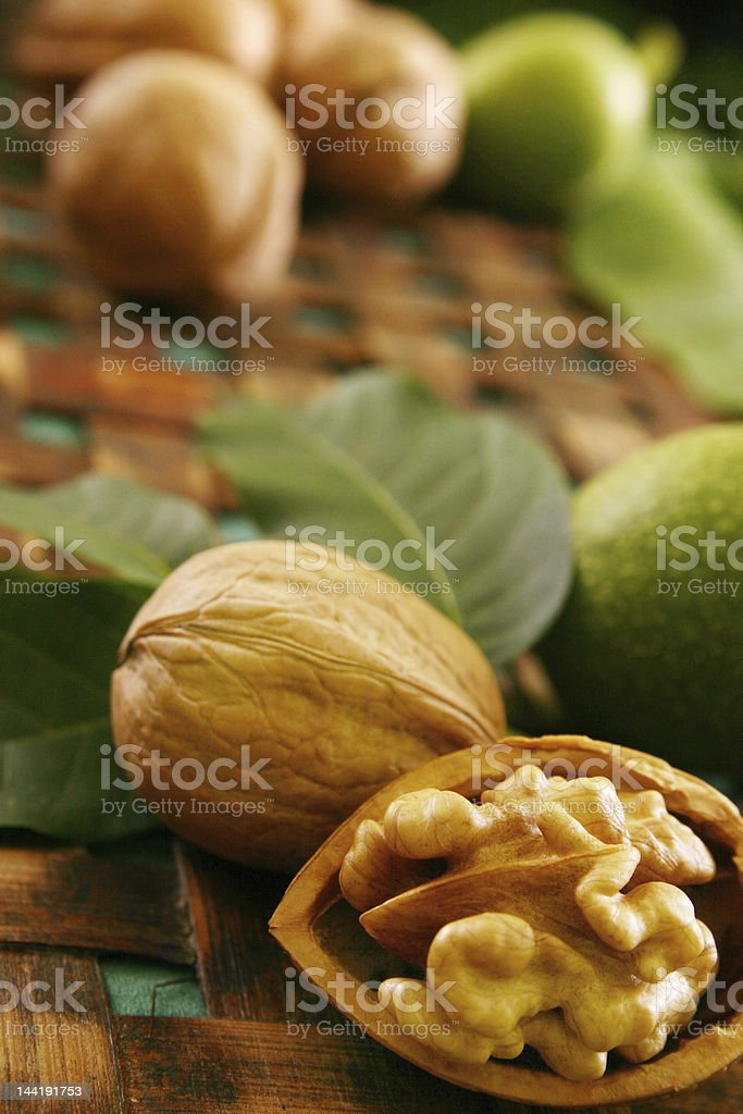 Close-up of chestnuts and leaves on table royalty-free stock photo