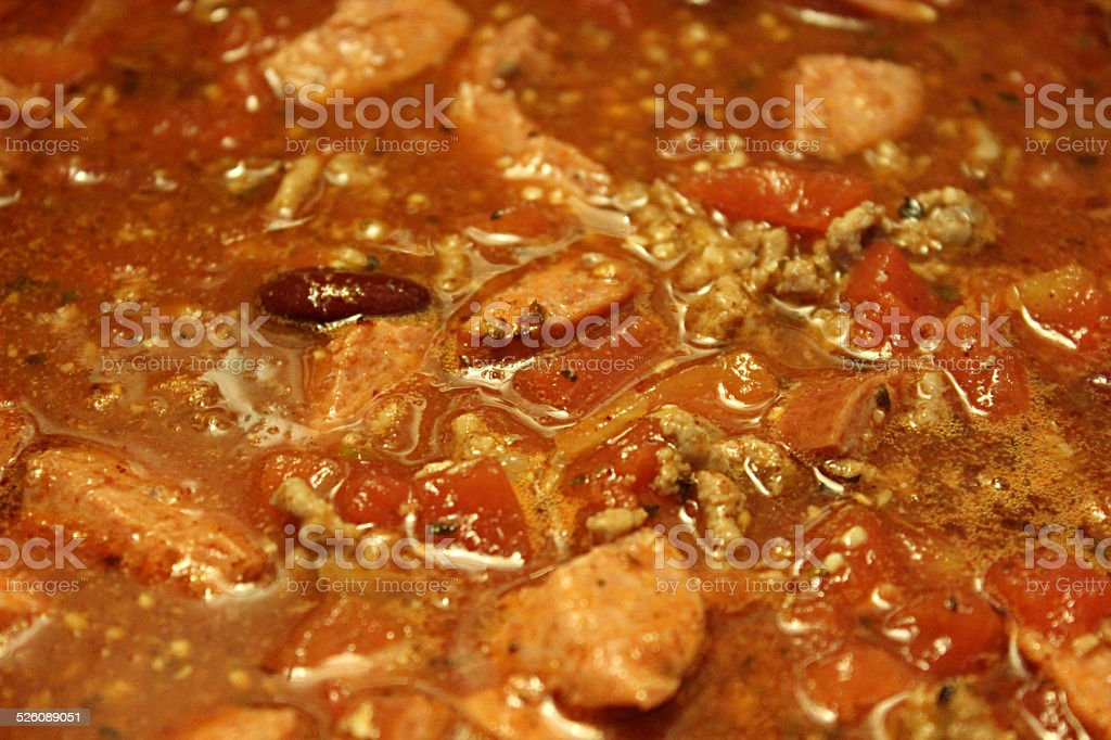 Close-up of Chili with Beans and Sausage Simmering on Stove stock photo