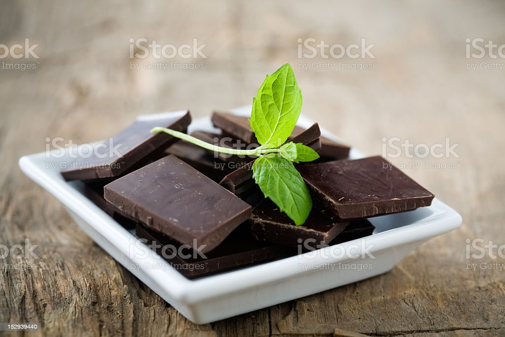 Close-up of chocolate squares with mint leaves on top stock photo