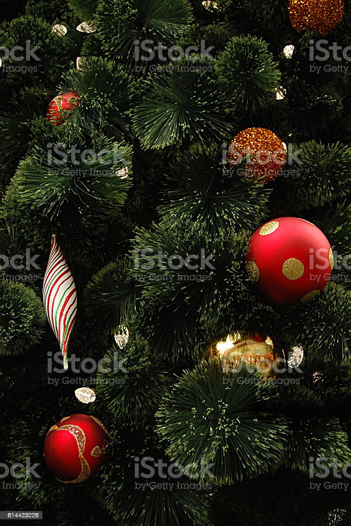 Closeup of Christmas tree with ornaments stock photo