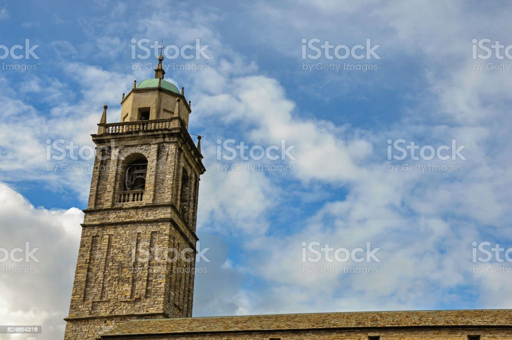 Close-up of church bell tower made of bricks in Bellagio stock photo