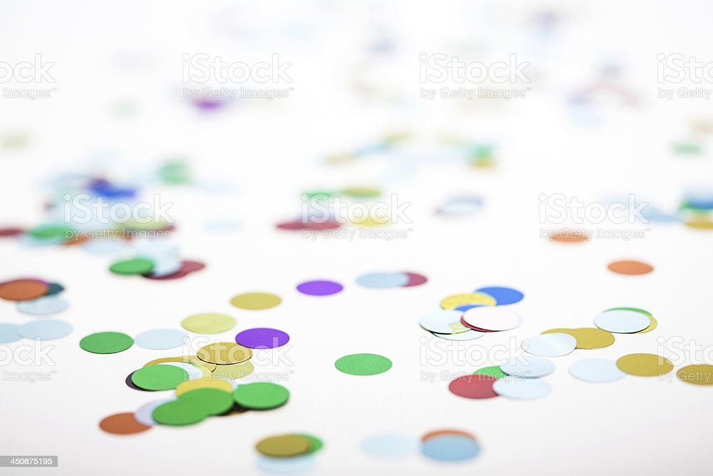 Close-up of circular, colorful confetti on white background royalty-free stock photo