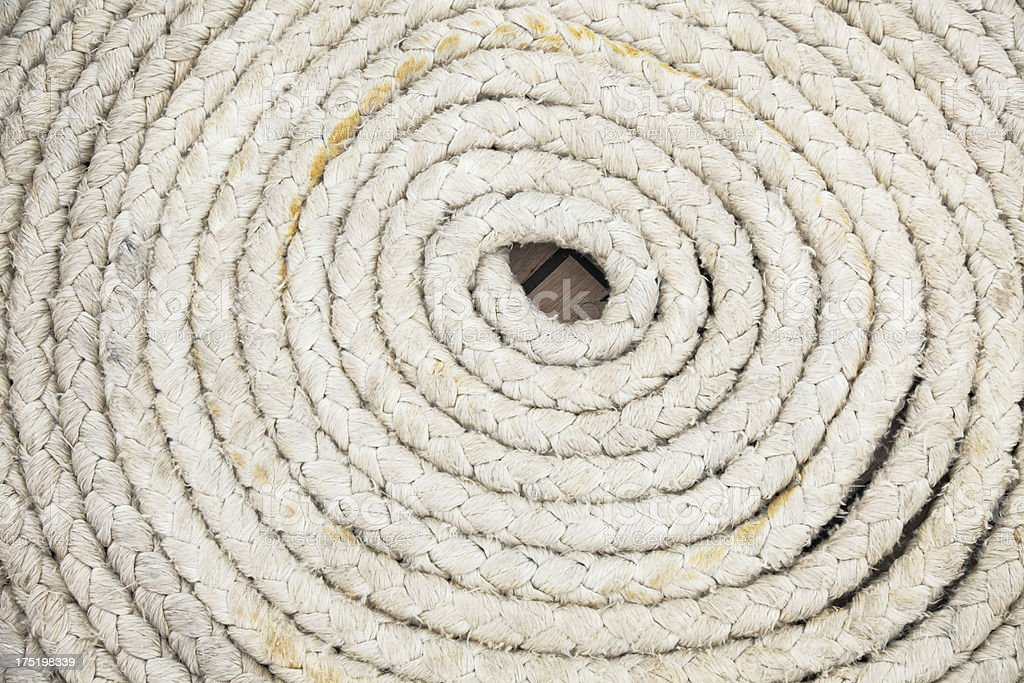 closeup of circular rolled up rope background on sailing ship royalty-free stock photo
