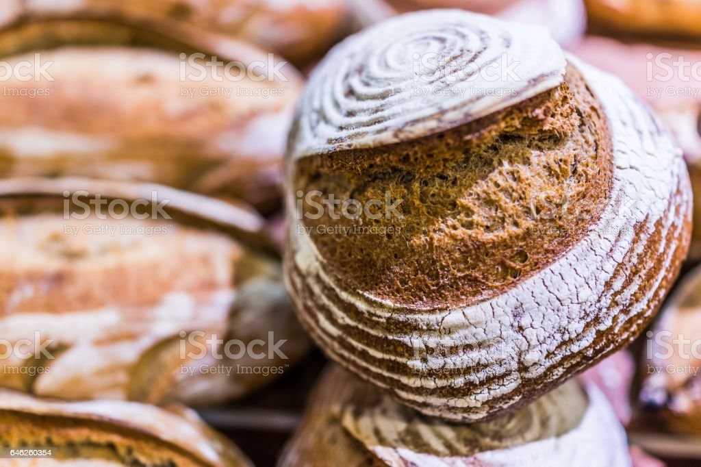Closeup of circular sourdough baked bread loaf in bakery stock photo