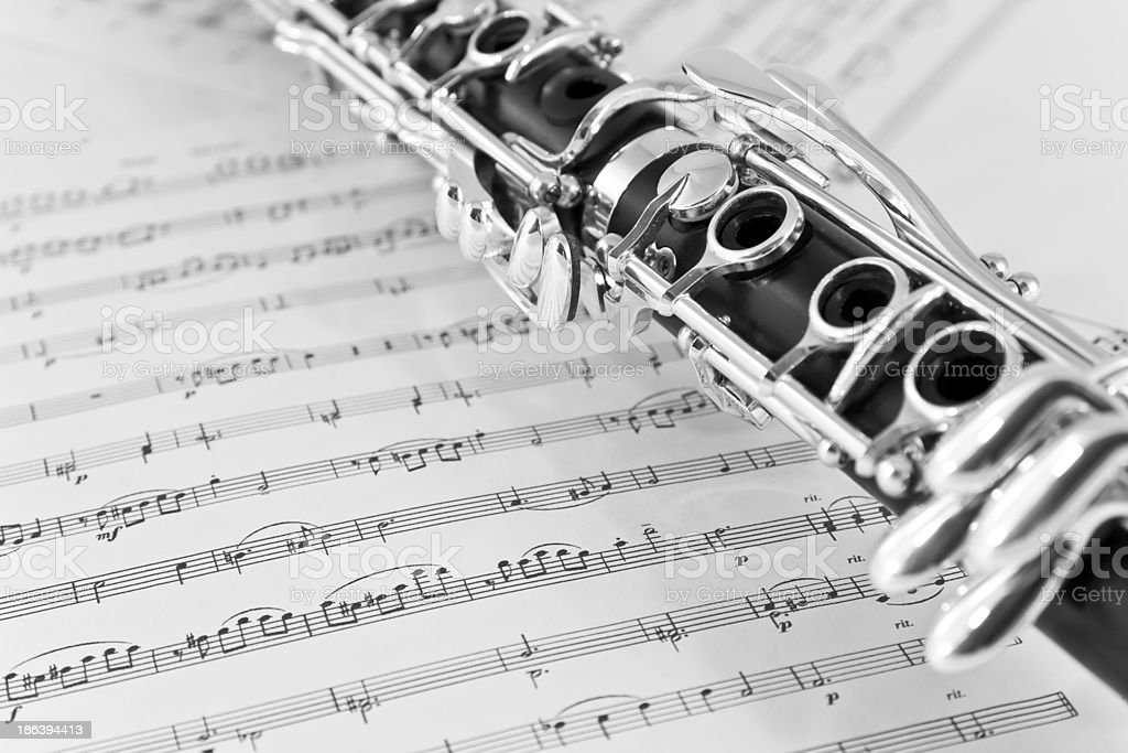 Close-up of clarinet on sheet music stock photo