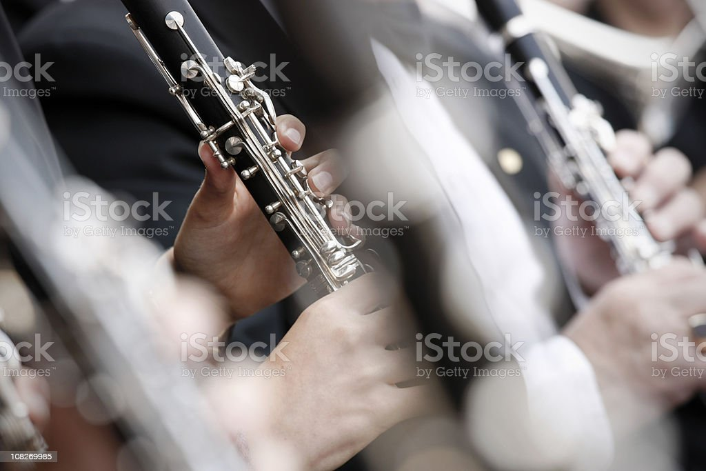 Close-up of clarinets playing in an orchestra with shallow DOF stock photo