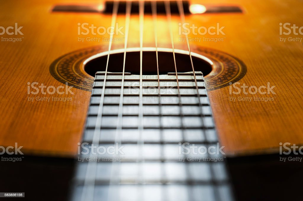 Close-up of classical guitar strings stock photo
