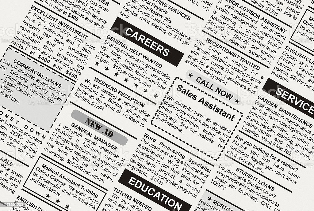 Closeup of classified ads in the newspaper stock photo