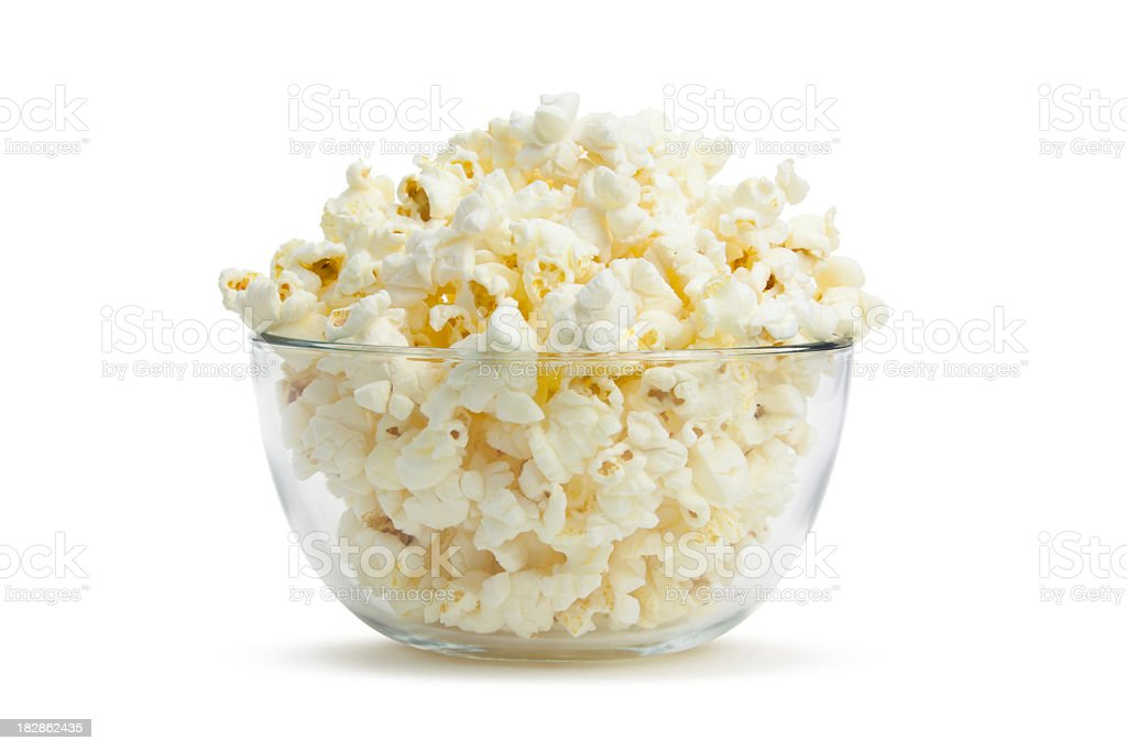 Close-up of clear bowl with freshly popped corn royalty-free stock photo