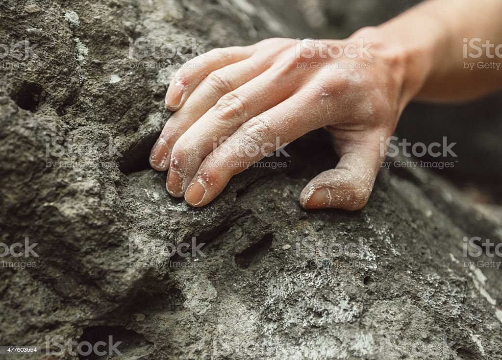 Close-up of climber hand on rock stock photo