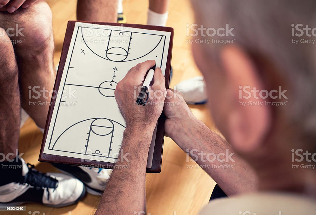 Close-up of coach making basketball strategy. stock photo