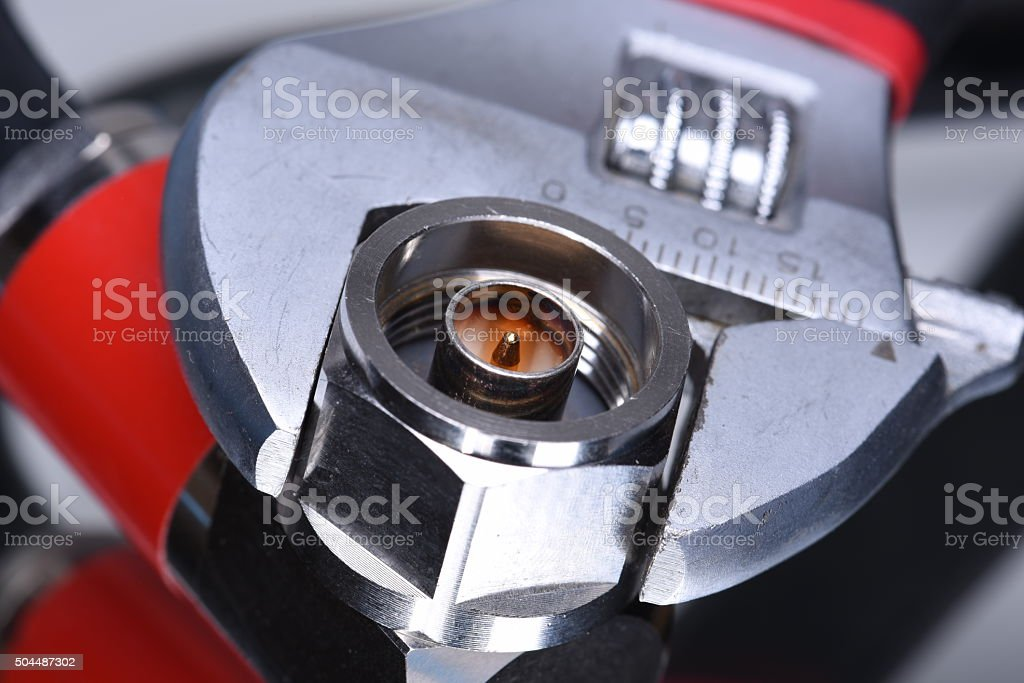 Closeup of coax connector with tool wrench stock photo