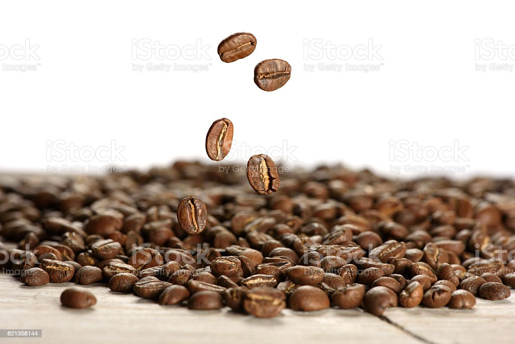 Closeup of coffee beans falling stock photo