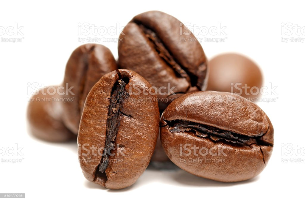 Close-up of coffee beans on white background stock photo