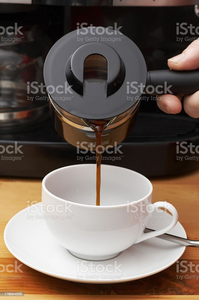 Closeup of coffee being poured into cup royalty-free stock photo
