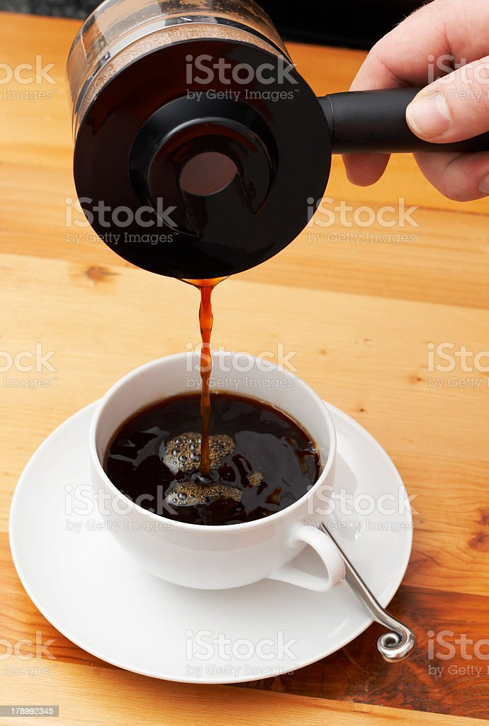 Closeup of coffee being poured into the cup royalty-free stock photo